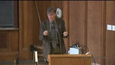 Screenshot from the lecture video showing Professor Blight speaking behind the podium