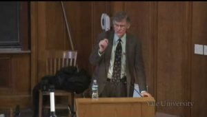 screenshot from the lecture showing Professor Blight speaking behind the podium