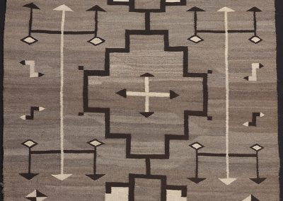image of a black, white and grey geometric Navajo blanket or rug