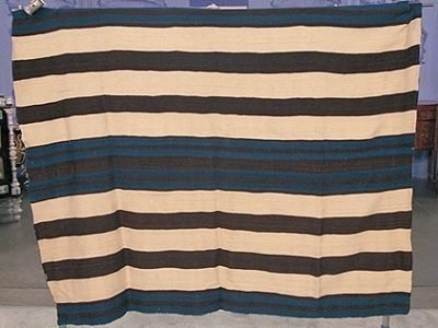 an indigo blue, black and white striped first phase chief's blanket