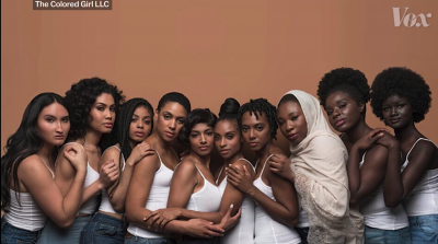 Screenshot from the video showing several black women lined up and posing for the camera