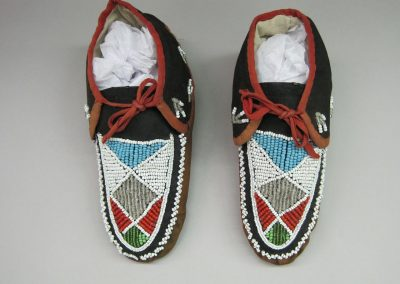 close-up image of 2 beaded moccasins