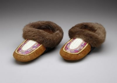 close-up image of 2 moccasins with fur lining