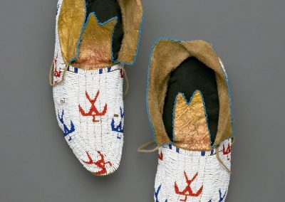 close-up image of 2 white beaded moccasins