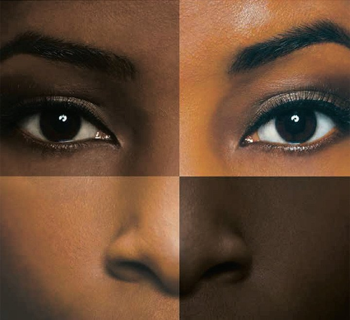 mosaic image of two eyes and two halves of a nose, compiled to create one face with many different skin shades