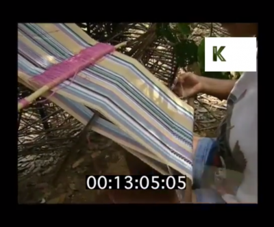 still image from the video clip showing someone weaving using a hand loom