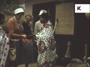 Still image from the archival footage showing Swaziland tribal women greeting white tourists