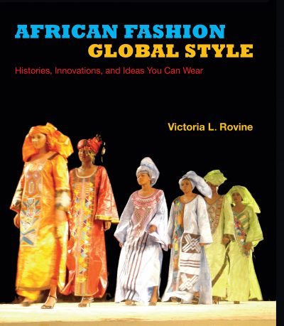 African Fashion Global Style book cover showing several models walking down a runway in African clothing