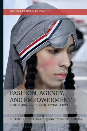 Book cover showing a closeup shot of a model wearing a grey hat with an eye mask on their forehead