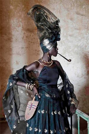 Editorial fashion portrait of a senegalese woman with a pipe