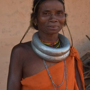 Portrait of a Gadaba woman, smiling into the camera.