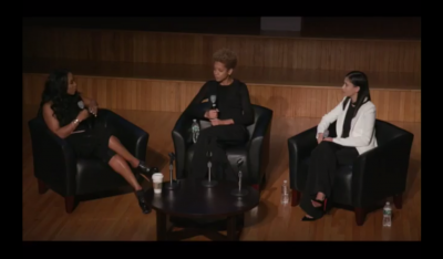 a still image from the lecture of June Ambrose, Carlie Cushnie and Michelle Ochs sitting and talking
