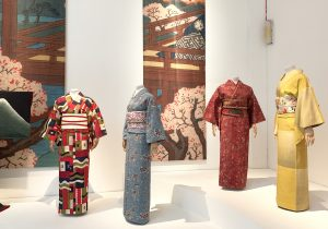 Museum display of 4 colourful women's Kimono