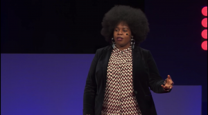 Still image of Mena Fombo speaking onstage