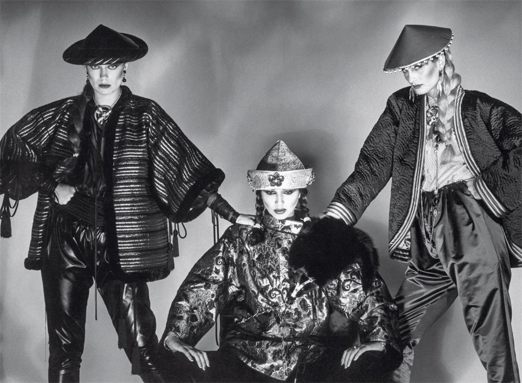 A black and white editorial featuring three white models wearing asian inspired clothing and conical hats