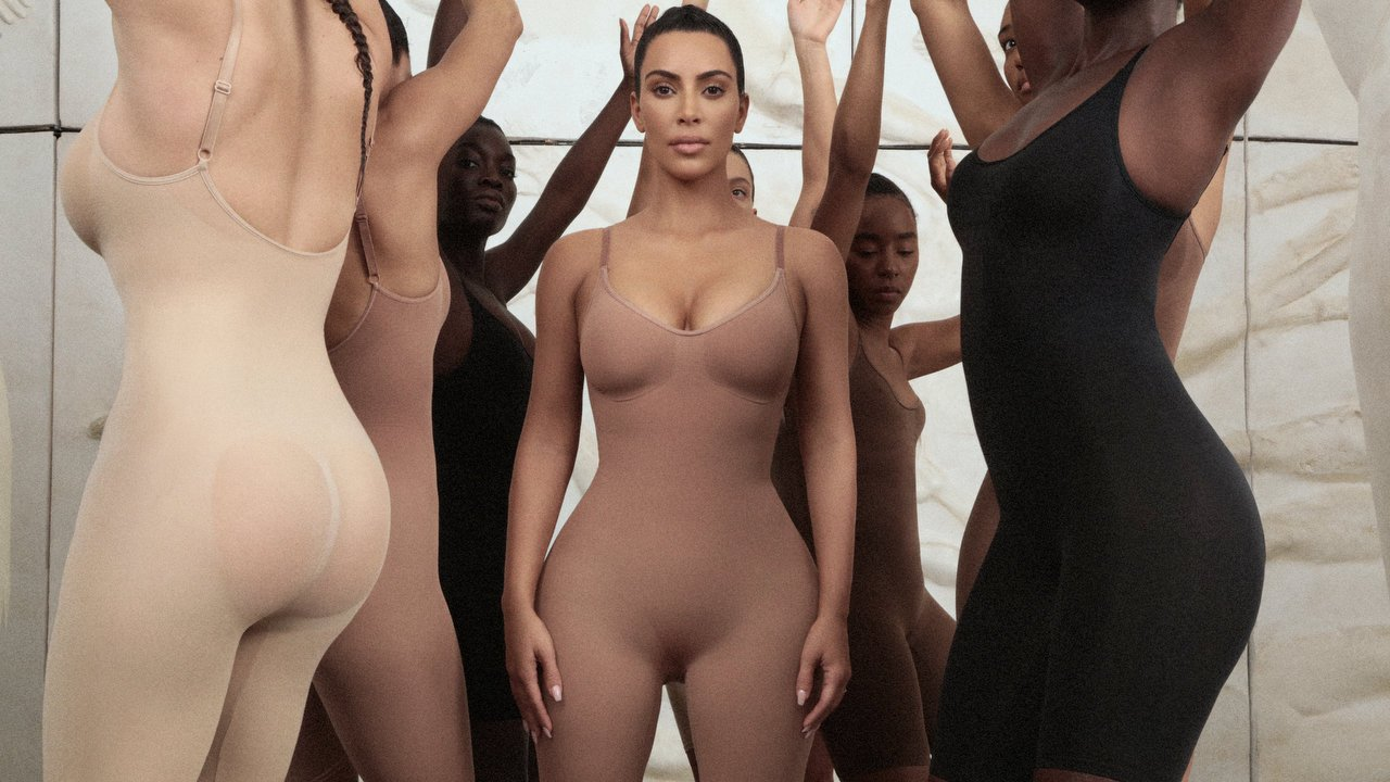 Image of Kim Kardashian surrounded by several models of different ethnicities all dressed in nude shape wear