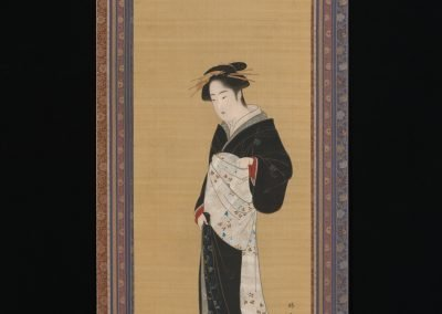 Photo of a hanging scroll showing an illustration of a Japanese woman in a traditional Black Kimono and white Obi sash