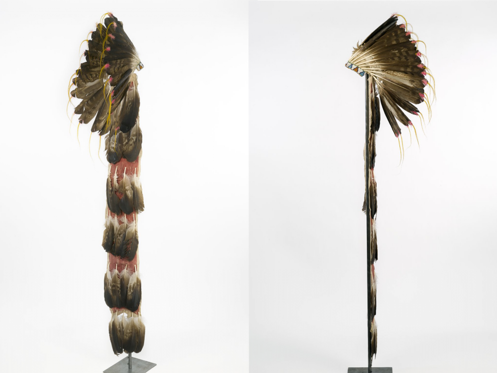 Museum catalog front and back view of an Eagle Feather War Bonnet with a long trailer