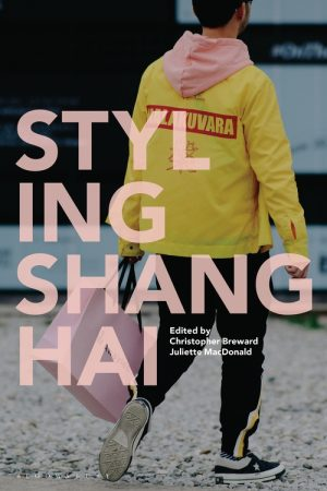 Styling Shanghai book cover with the title text overlaying an image of a shopper wearing a yellow jacket