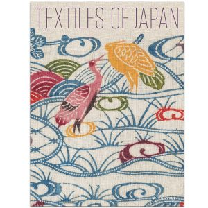 Textiles of Japan book cover is a closeup of a printed fabric showing storks in a wave pattern