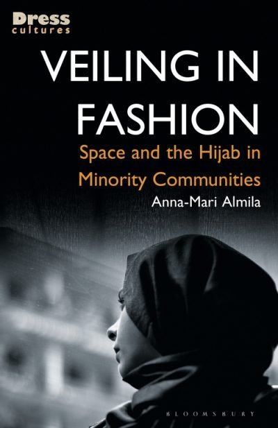 Veiling in Fashion book cover featuring a black and white image of a woman wearing a hijab looking to the left