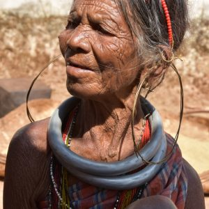 Profile portrait of a Gadaba woman named Samari Sisa, looking slightly to the left. She wears large hoops in her ears