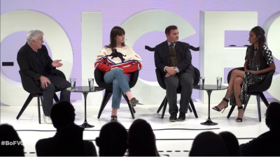 Image from the recorded event of the panelists on stage