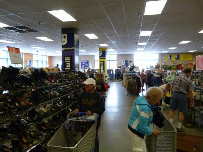Photo from the article showing several shoppers in a goodwill