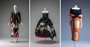 3 Kimono inspired black, red and white garments on display on mannequins in front of grey backdrops