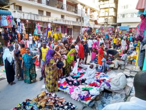 Photo from the article of a busy clothing market in East Africa