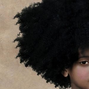Illustration of a young Black girl with a large coily afro