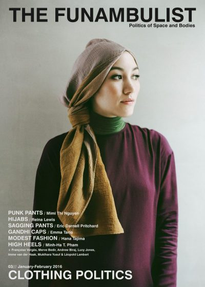 Magazine cover of woman wearing a burgundy top over a green turtleneck and mauve scarf on her head looking towards the right.