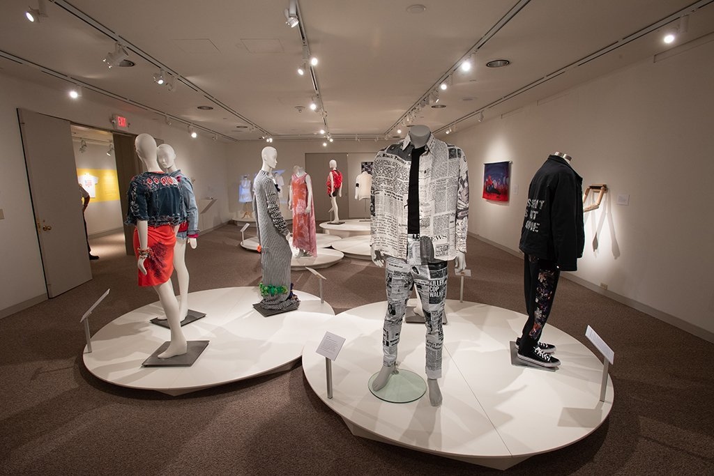 Inside view of the wearing justice exhibition featuring several mannequins in different garments