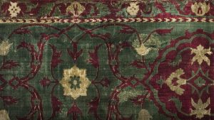 Closeup of a velvet Persian rug