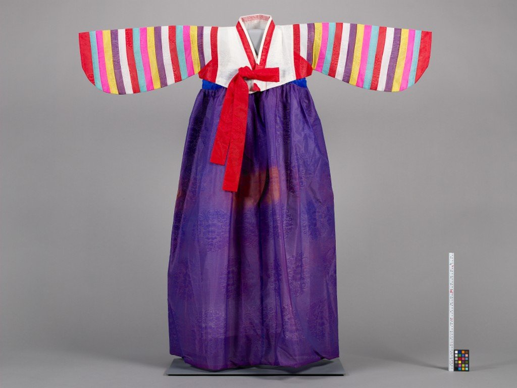 Hanbok, a traditional Korean dress with purple skirt and multicolored sleeves and top