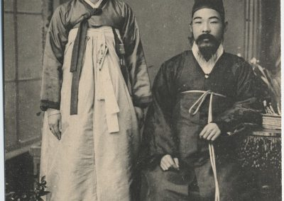 Vintage black and white portrait of husband and wife in traditional Hanboks