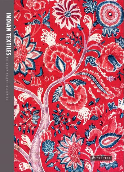 Book cover with a floral pattern with stylized flowers, paisley leaves, and undulating branches over a red ground