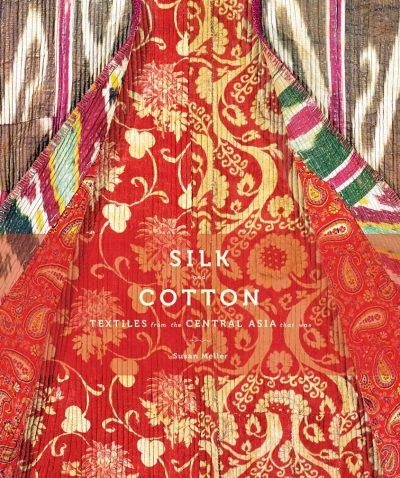 book cover picturing layers of textiles with different colours and patterns. The main one in the center has golden flowers, leaves, and scrolling motifs on a bright red ground.