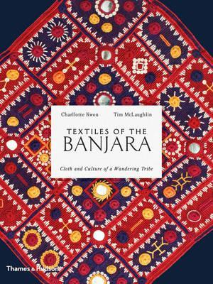 Book cover featuring a Banjara textile with a geometric pattern in red and blue, embroidered with white thread and small appliques of various colours