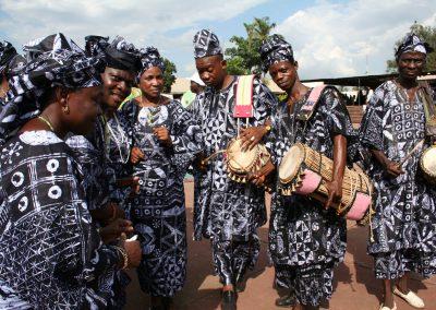 'Yoruba dancers inadire.'Courtesy of Ayo Adewunmi (Own work) https://commons.wikimedia.org/wiki/File:Ayo_Adewunmi_-_Yoruba_Dancers.jpgvia Wikimedia Commons Image Permission.