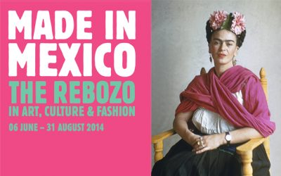 Exhibition flyer with title, dates, and an image of Mexican artist Frida Kahlo wearing a flower headband and a pink rebozo