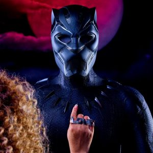 Photo of a Black Panther costume with a woman's hand pointing to it