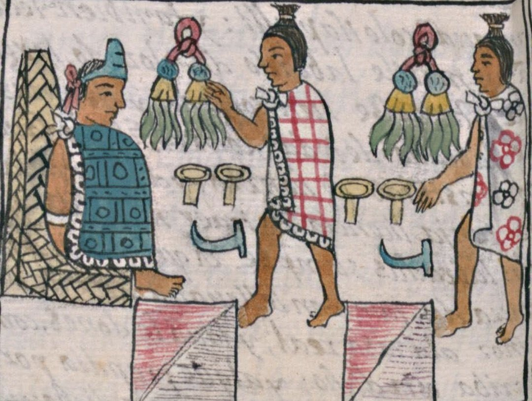 Close-up of an illustrated page of an Aztec codex, showing one person approaching another person of higher rank, who appears seated and wearing an elaborate blue tunic