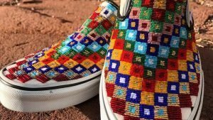 Close-up of beaded vans with multi-color squared patterns