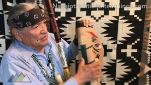Navajo historian Wally Brown showing Navajo weavings