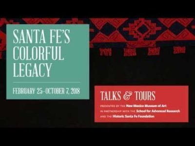Two text boxes with details of the panel and a black-and-red Pueblo textile in the background