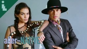 Two models wearing Native American fashion designs