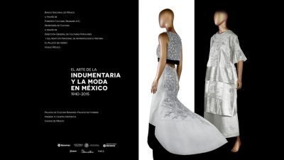 Text with details of the exhibition on the left and two mannequins on the right with white and black dresses