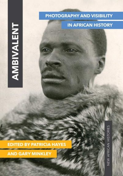 Book cover with black-and-white photograph portrait of man with moustache wearing a fur garment around his shoulders