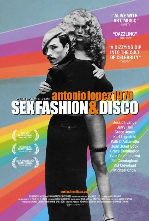 Film poster with black-and-white image of a man dressed in black with a mustache and a beret, carrying a woman with blonde, curly hair, over a multi-colored background